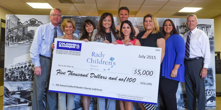 Coldwell Banker Hits the Green for Charity